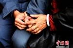 资料图:四川省荞窝监狱举办亲情帮教活动,助服刑人员改造。安源 摄 - 妇女联合会