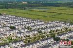 航拍宿迁市宿豫区整齐有序的农民住房,呈现和谐美好的画面。 泱波 摄 - 江苏新闻网